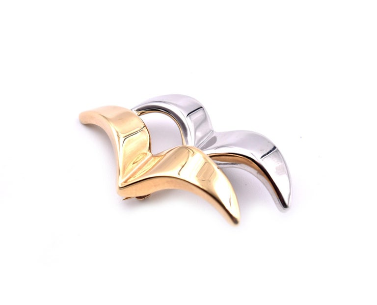 Designer: custom design Material: 14k yellow and white gold Dimensions: pin measures 21.50mm long and 41mm wide Weight: 2.42 grams
