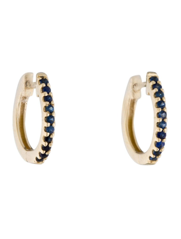 Contemporary 14K Yellow Gold 0.18 Carat Blue Sapphire Huggie Hoop Earrings For Sale