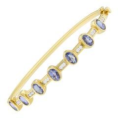 14K Yellow Gold 1/3 Cttw Diamond and Blue Oval Tanzanite Bangle Bracelet