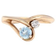 14 Karat Yellow Gold Aquamarine and Diamond Minimalist Ring