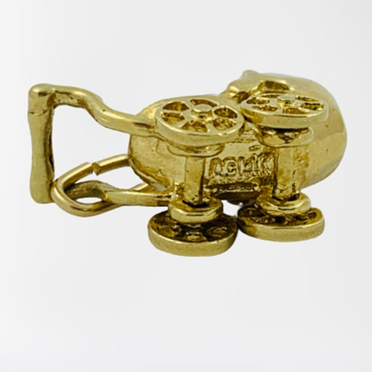 Art Deco 14 Karat Yellow Gold Articulating Baby Carriage Charm Pendant For Sale