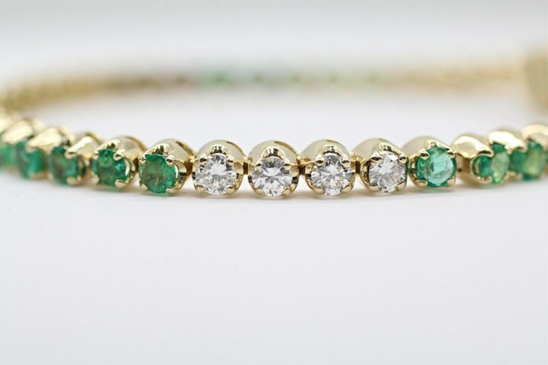 This is very beautiful 14k yellow gold custom made bracelet with very clean emeralds and round diamonds. This bracelet has 45 pieces of stones in approximately 4.00 carat total weight, E color and VS1 in clarity.. Specifications:     main stone: