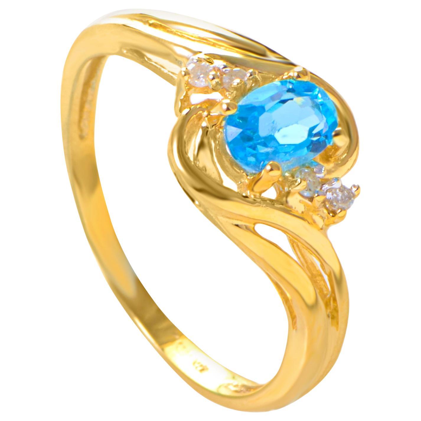 14 Karat Yellow Gold Diamond and Topaz Ring