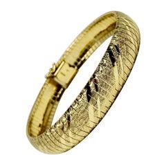 14 Karat Yellow Gold Diamond Cut Etched Omega Link Bracelet