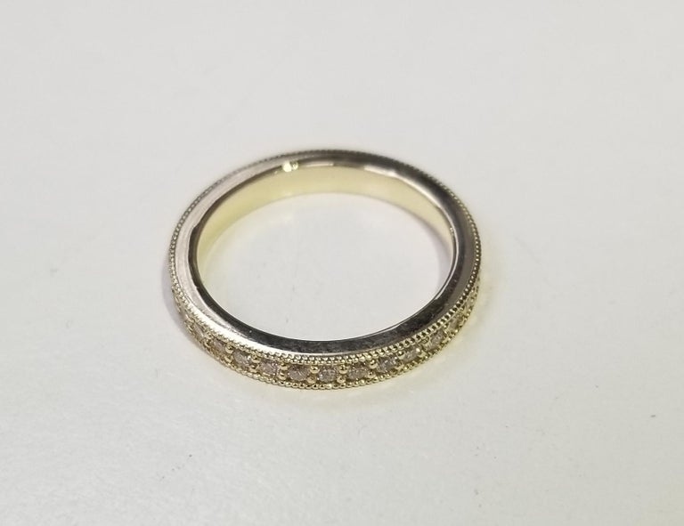 14k yellow gold diamond eternity ring with milgrain Specifications:     diamonds: 34 PCS ROUND CUT DIAMONDS     carat total weight: APPROX .58 CTw     color: G     clarity: VS2     metal: GOLD     type: WEDDING BAND ring     weight:  2.8 GrS