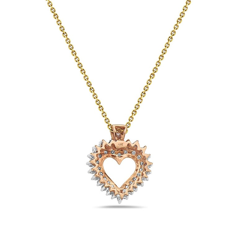 This pendant necklace features 0.95 carats of round diamonds and 0.05 carats of baguette diamonds. 16 inch chain included. Chain included may vary from chain shown in the photo.    Viewings available in our NYC showroom by appointment.