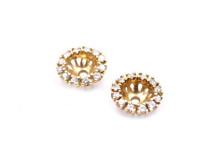 Designer: custom design Material: 14k yellow gold Diamonds: 24 round brilliant cut =.75cttw Color: G Clarity: VS Dimension: diameter is 10.75mm, 2.90mm thick and each center will gold up to a .80 carat diamond earring. Weight: 2.25 grams