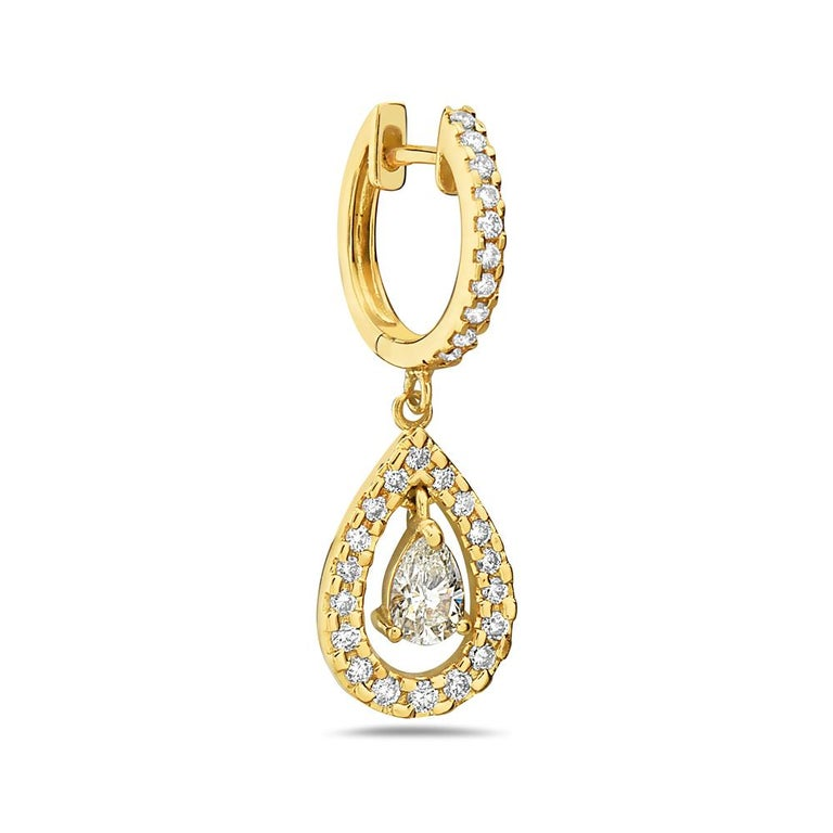 These 14K yellow gold G VS pave diamond encrusted hoop earrings feature a pear cut dangle diamond with a diamond encrusted halo. 0.66 carat pear diamonds and 0.5 carat round pave diamonds. Made in USA.  Viewings available in our NYC showroom by