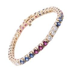 14 Karat Yellow Gold Diamond, Ruby, and Sapphire Tennis Bracelet