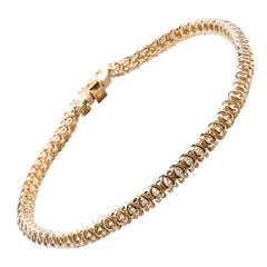 14 Karat Yellow Gold Diamond Tennis Bracelet with Trellis Setting