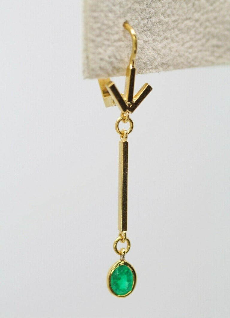 Contemporary 14 Karat Yellow Gold Emerald Drop Earrings For Sale
