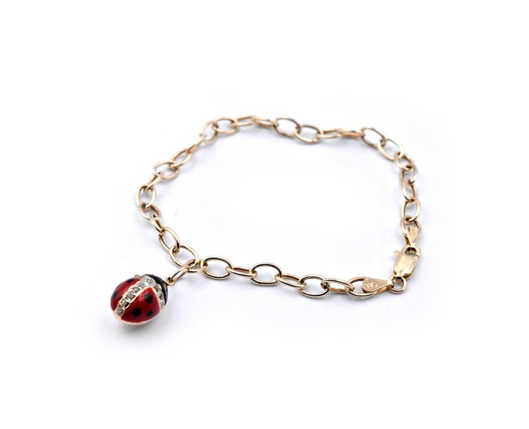 Designer: custom design  Material: 14k yellow gold Dimensions: bracelet measures 7 inches in length and ladybug measures 12.95mm long Weight: 2.47 grams