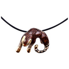 14 Karat Yellow Gold Enamel Leopard on Rubber Cord with Sterling Silver Clasp