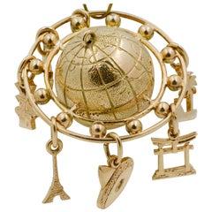 14 Karat Yellow Gold Globe and Mini Charm Pendant
