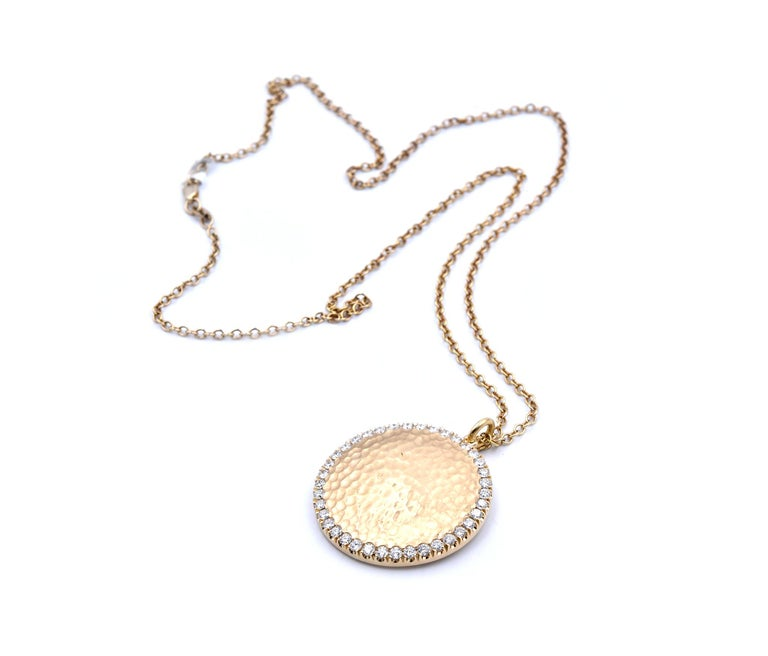 Material: 14k yellow gold Diamonds: 38 round brilliant cuts = 1.25cttw Color: G Clarity: VS Dimensions: necklace is 20-inches in length, pendant measures 29.60mm in diameter Weight: 20.3 grams