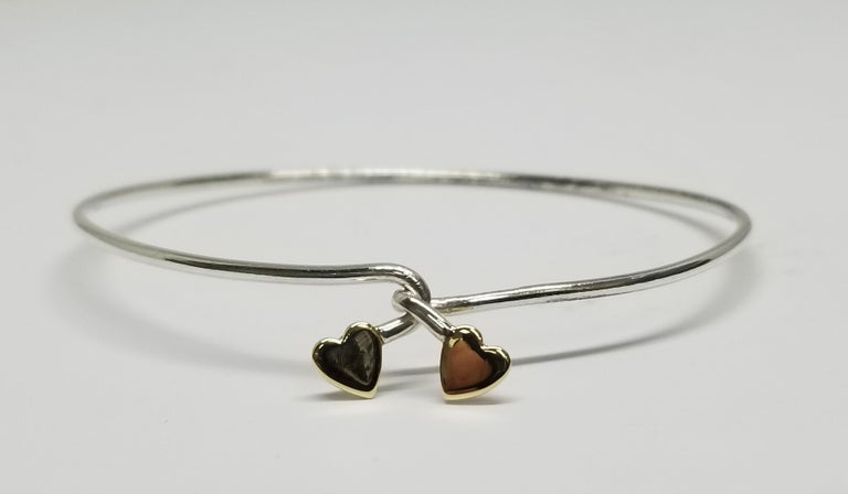 14k yellow gold heart and sterling silver 1.5mm wire bracelet, bracelet opens in the middle and closes to make the