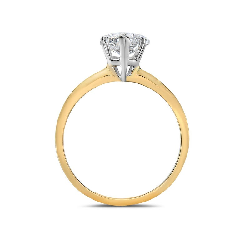 This ring features a 1.06 carat H-I I1-I2 heart shape diamond set in 14K gold. Made in USA.   Viewings available in our NYC showroom by appointment.