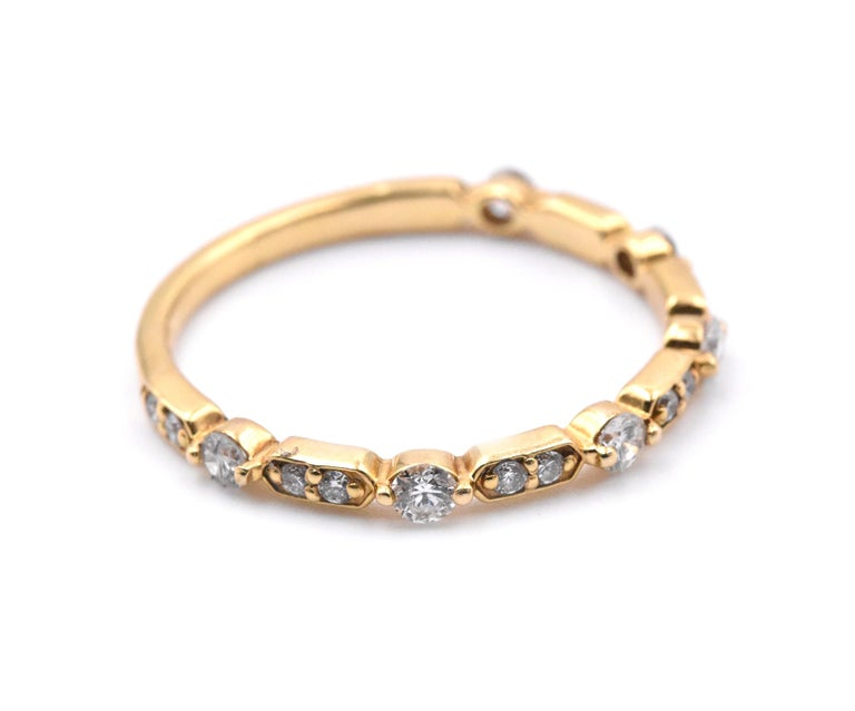 Designer: custom Material: 14k yellow gold Diamonds: 20 round brilliant cuts = 0.39cttw Size: 7 (please allow two additional shipping days for sizing requests)   Dimensions: ring measures 1.40mm in width Weight: 1.59 grams