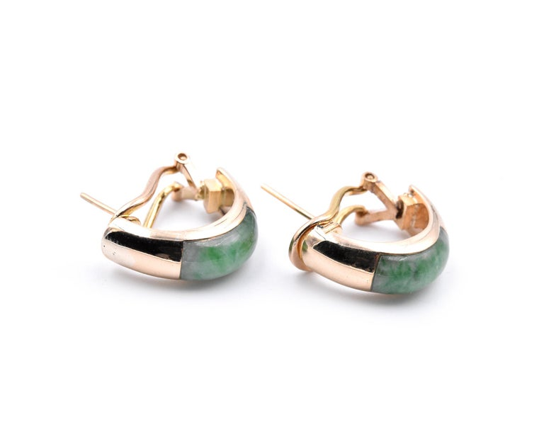 Material: 14k yellow gold Gemstone: Jade Dimensions: earrings measure 19.50mm x 6.85mm Fastenings: post with omega back Weight: 8.30 grams