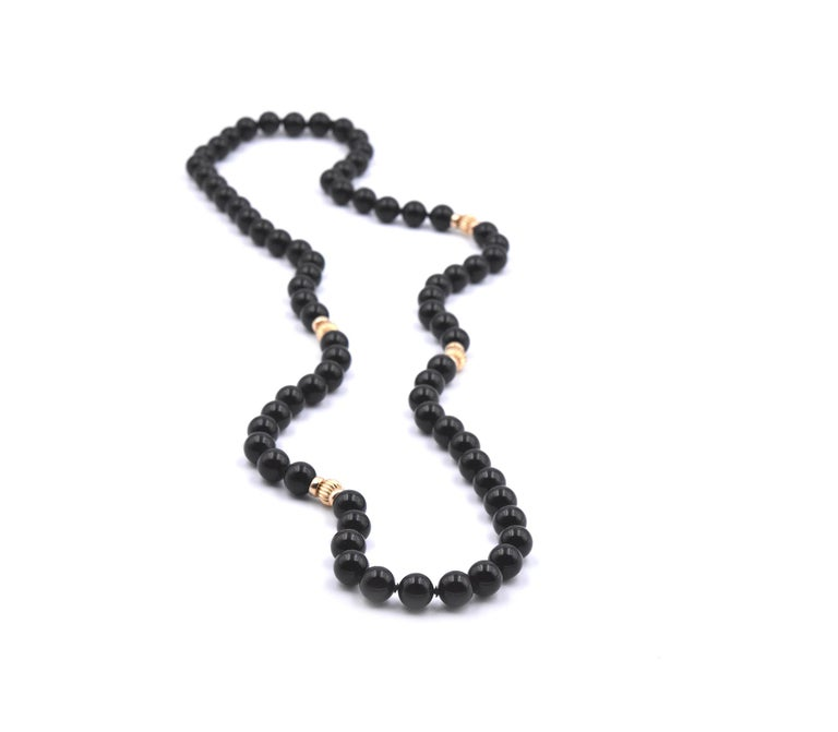 Designer: custom designed Material: 14k yellow gold Onyx: 10mm onyx beads Dimensions: necklace is 32 inches long Weight: 100.35 grams
