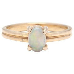14 Karat Yellow Gold and Opal Solitaire Ring