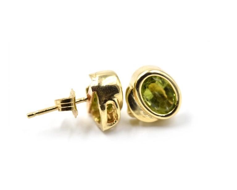 Oval Cut 14 Karat Yellow Gold Peridot Stud Earrings For Sale