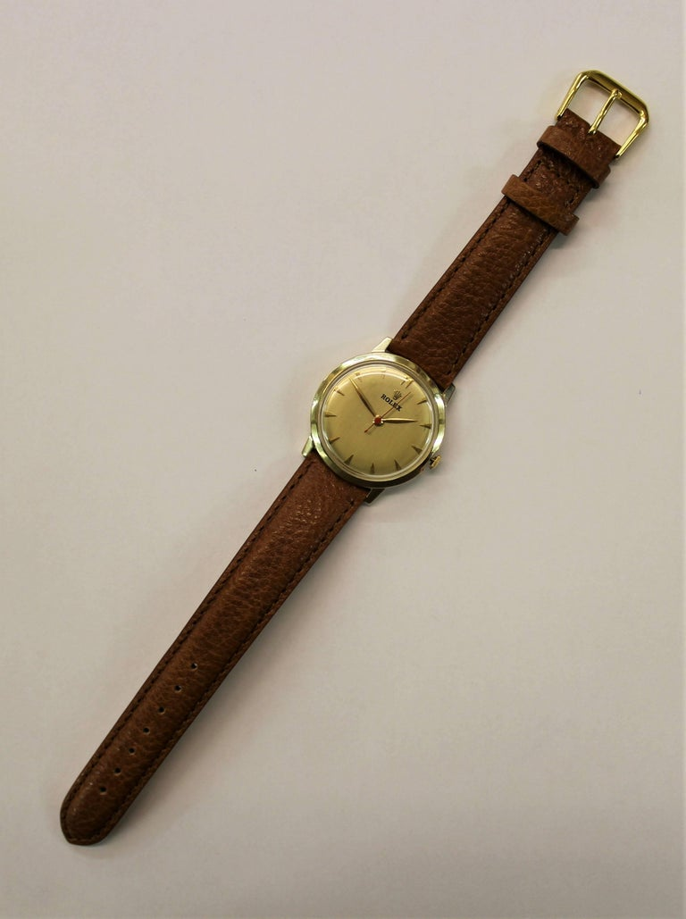 14-karat yellow gold Montres Rolex Geneva Swiss watch with a genuine calfskin leather strap, circa 1945. -17 jewels -Model number 1210 - Weight of case 10.8 grams -Measure: Case diameter 33 mm -Crown size 4.2 mm -Height 9.5 mm -Serial number