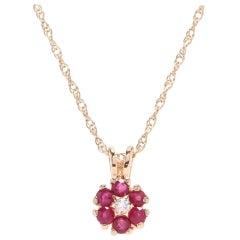 14 Karat Yellow Gold, Ruby, Diamond Flower Pendant Necklace