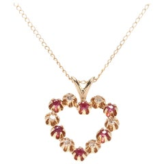 14 Karat Yellow Gold, Ruby, Diamond Heart Pendant Necklace