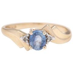 14 Karat Yellow Gold, Sapphire, Diamond Bypass Ring