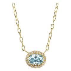 14 Karat Yellow Gold Sky Blue Topaz and Diamond Halo Necklace
