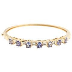 14 Karat Yellow Gold, Tanzanite and Baguette Diamond Bangle Bracelet