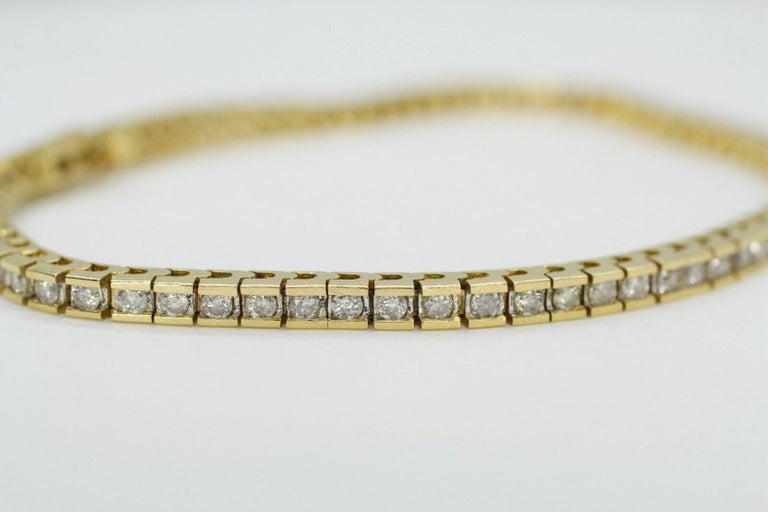 Contemporary 14 Karat Yellow Gold Tennis Bracelet 2.10 Carat Total Weight For Sale