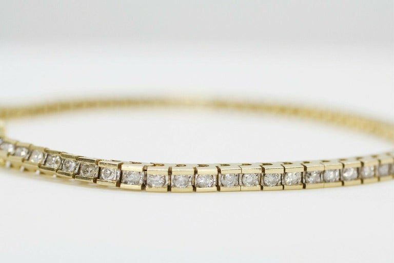 This is a beautiful illusion 14K yellow gold tennis bracelet. This features 76 pieces of round cut diamonds in approximately 2.10 carat total weight.  Specifications:     main stone: ROUND CUT DIAMONDS     diamonds: 76 PCS     carat total weight: