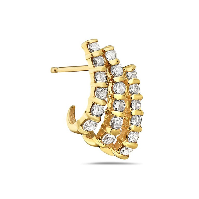 These earrings feature three rows of 1.25 carats round diamonds set in 14K yellow gold. 4.5 grams total weight. Made in USA.   Viewings available in our NYC showroom by appointment.