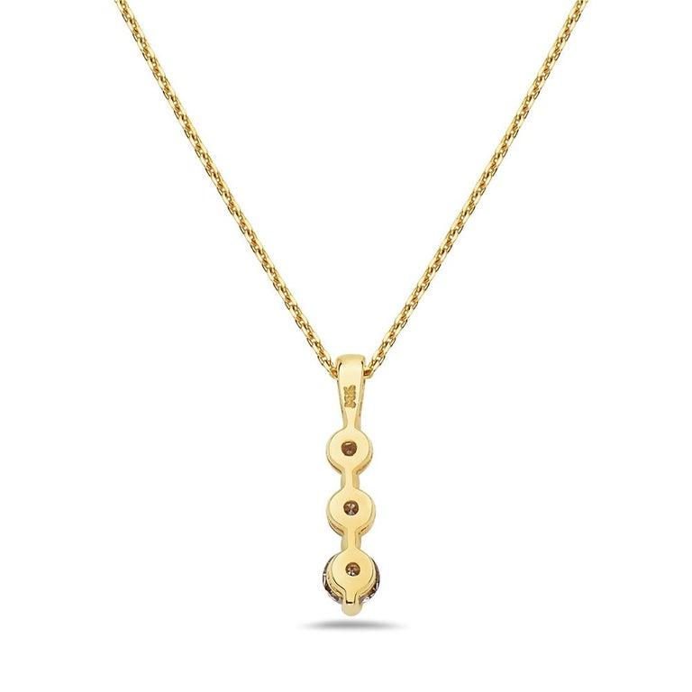 Modern 14 Karat Yellow Gold Three-Stone Diamond Pendant Necklace For Sale