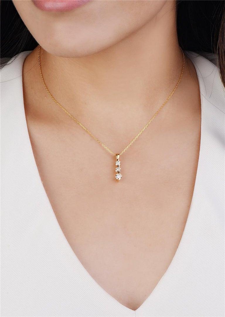 Round Cut 14 Karat Yellow Gold Three-Stone Diamond Pendant Necklace For Sale