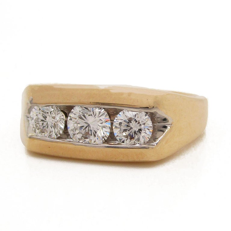 This absolutely incredible ring is a signed Leo Diamond piece by Leo Schachter Diamond Incorporated! The three diamonds are G in color, VS2 in clarity, and round in cut. Leo Diamonds are certified and designed to be visibly brighter. These diamonds