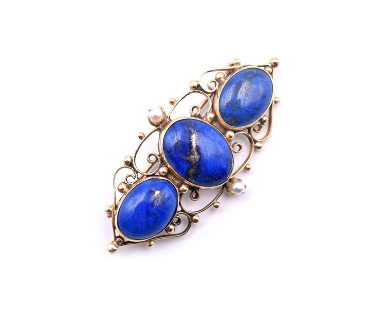 Designer: custom design  Material: 14k yellow gold Gemstone: lapis Dimensions: pin is approximately 25.45mm by 2-inches wide Weight: 8.3 grams