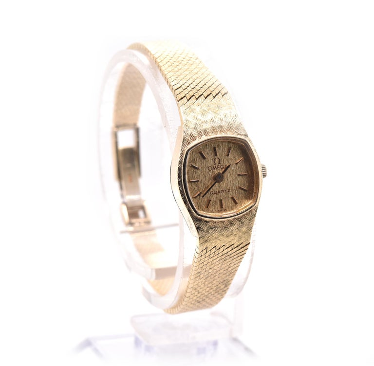 Brand: Omega Movement: automatic  Function: hours, minutes Case: 14k yellow gold Band: Omega 14k yellow gold Dial: Factory champagne sticks Serial: 1375   No Box or papers. Guaranteed to be authentic by seller.
