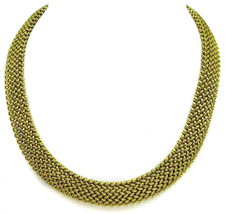 This fabulous 14k yellow gold necklace and bracelet set features an impressive weave motif. The bracelet measures 14mm in width and 7 1/2 inches in length and the necklace measures 17 1/4 inches in length and 14mm in width. They are stamped 585