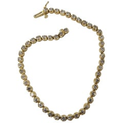 14k YG Tennis Bracelet with 49 Diamonds Color G-H and Clarity SI1 Weighing 2.10