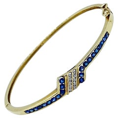 14KT Gold Bangle Bracelet with 1.15 Carat Blue Sapphires and .20 Carat Diamonds