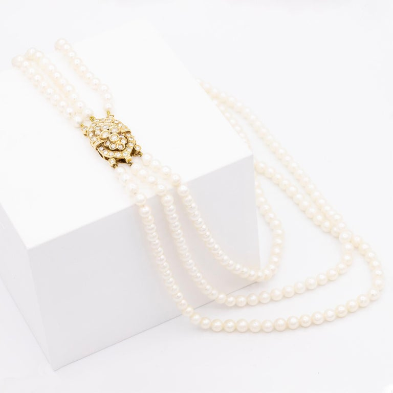 Modern 14 Karat Gold and Diamond Three Strand Freshwater Pearl Necklace For Sale