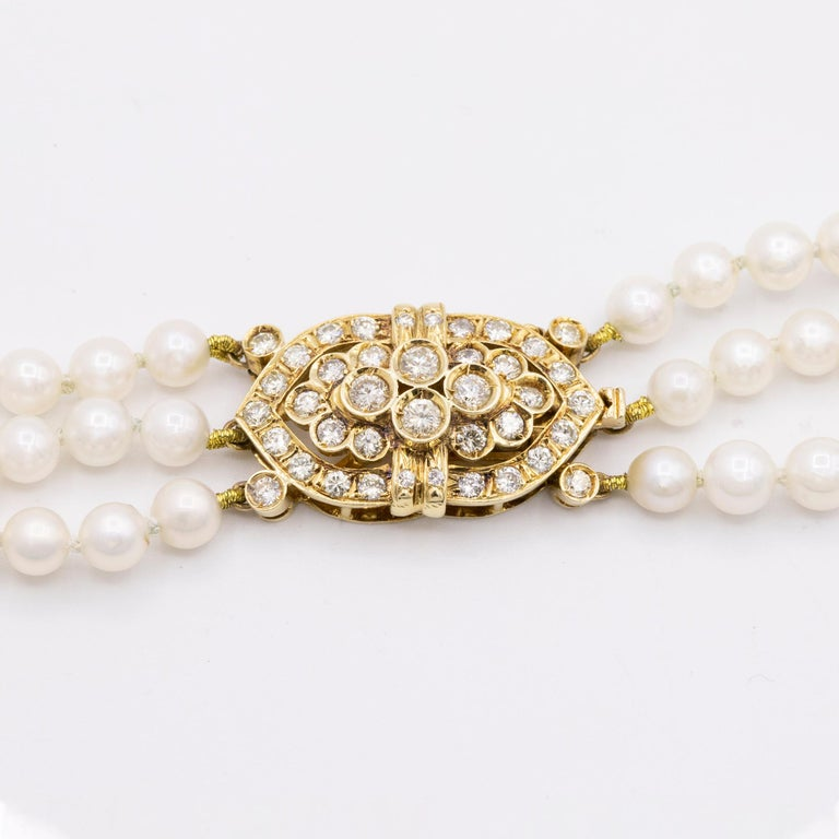 Round Cut 14 Karat Gold and Diamond Three Strand Freshwater Pearl Necklace For Sale