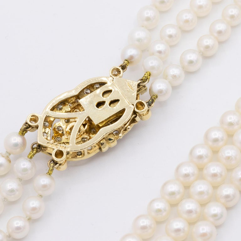 14 Karat Gold and Diamond Three Strand Freshwater Pearl Necklace In Excellent Condition For Sale In Princeton, NJ