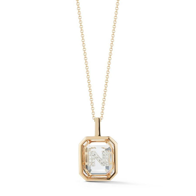 Beautifully handcrafted in New York of solid 14K Yellow Gold set with our special emerald cut crystal quartz. The personalized diamond pave initial is then set/hidden underneath the gemstone.  Our gemstone initial collection offers an elevated take