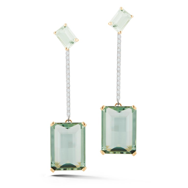 Beautifully handcrafted in New York of solid 14kt yellow gold, emerald cut amethyst of two shades with brilliant diamonds.  These strikingly beautiful earrings are the perfect way to add color to ones look and stand out.