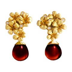 14kt Gold Plum Flowers Contemporary Clip-On Earrings with Diamonds and Garnet