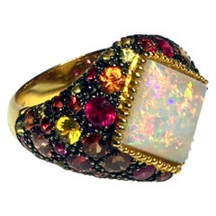 14 Karat Gold Ring Set with Opal and Sapphire